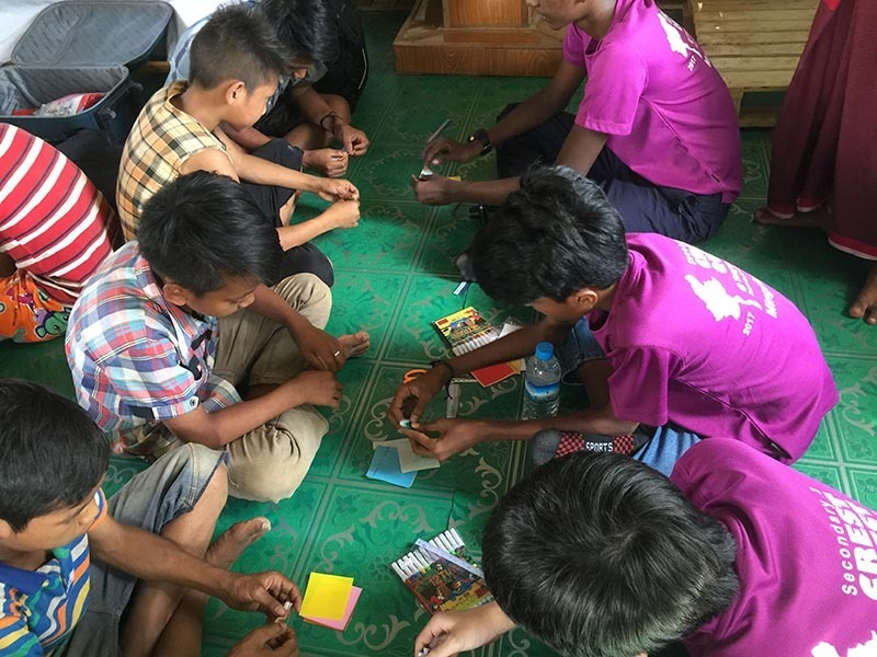 Exhibiting iCrest values while teaching the orphans simple paper craft work.JPG