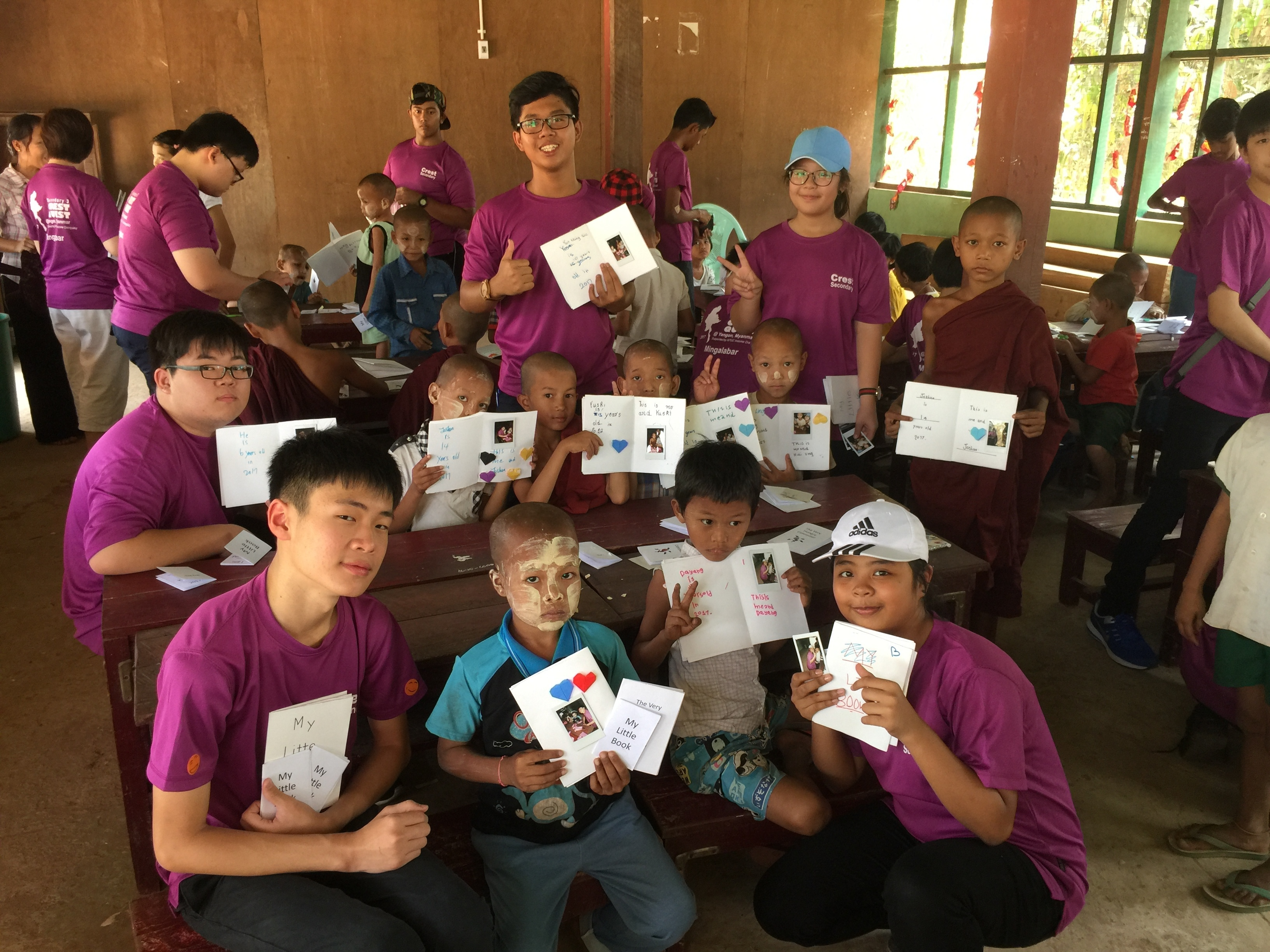 Receiving their cards of love from their young Vietnam friends.JPG