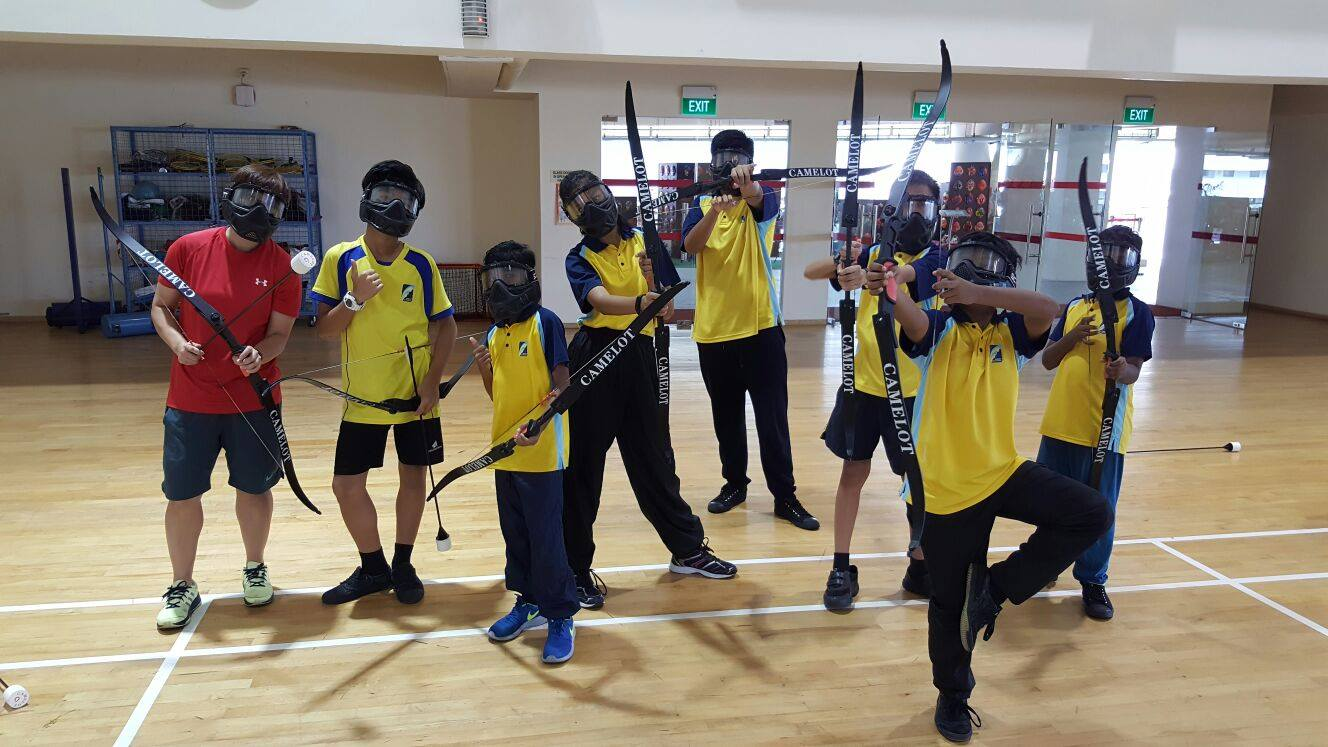 Sec 1 warriors trying their hands on combat archery.jpg