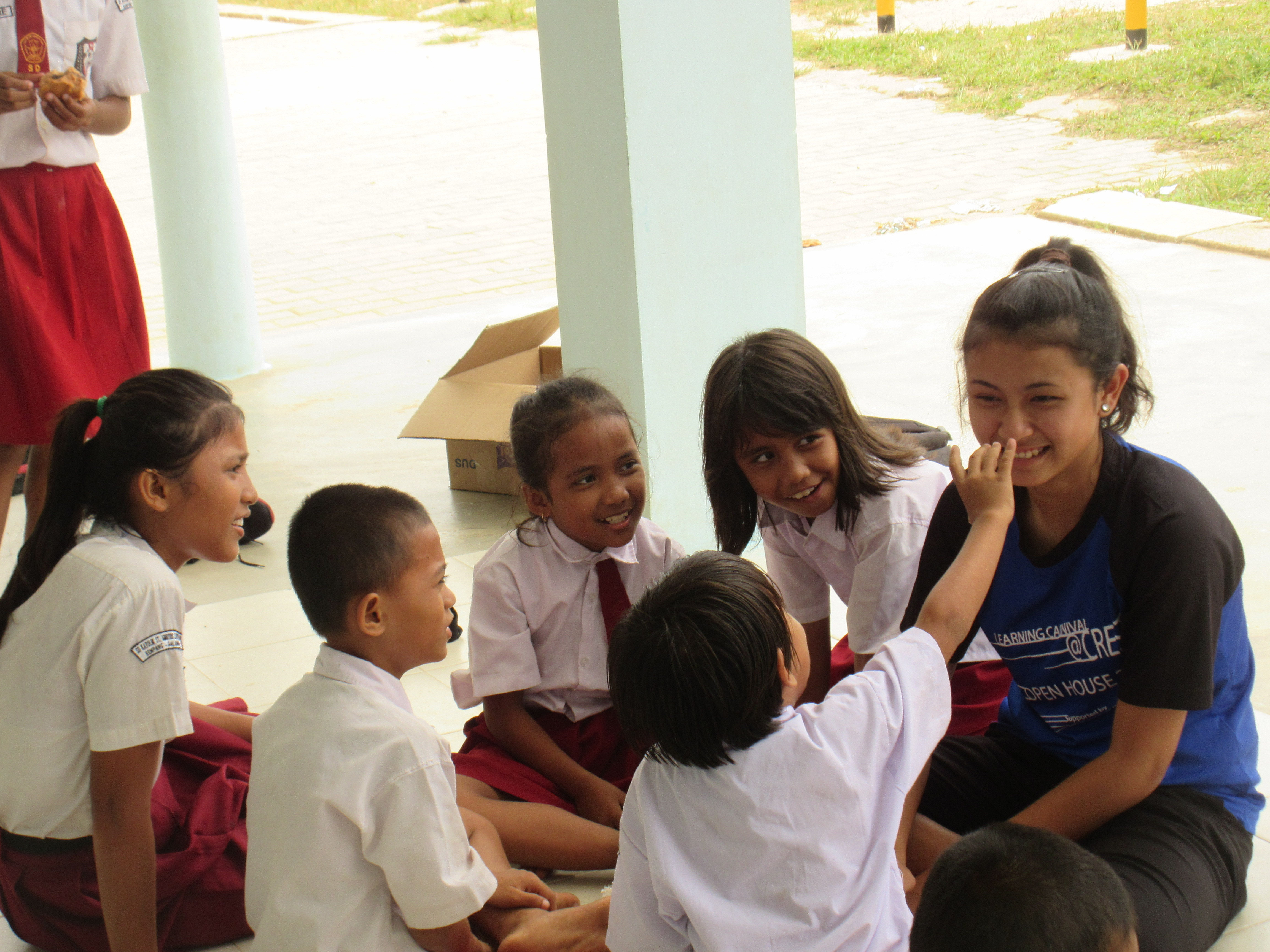 Showing sisterly love to the less fortunate kids in overseas service learning.JPG